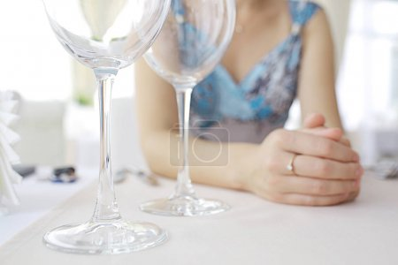 two wineglasses on table