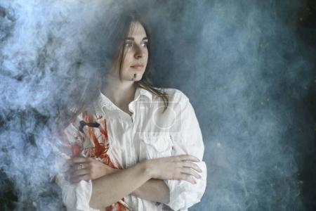 Photo for Portrait of beautiful young woman in white shirt with paint stains, white smoke effect - Royalty Free Image
