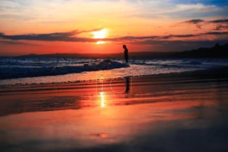 A man walking on the beach