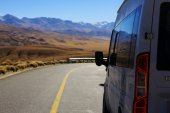 asphalt road in Tibetan plateau mountains, picturesque landscape