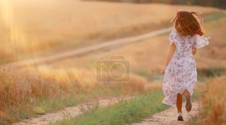 Photo for Happy girl freedom in summer field, glare of the sun abstract background france provence autumn - Royalty Free Image
