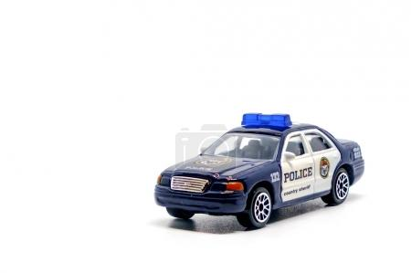 Police car toy model on white background