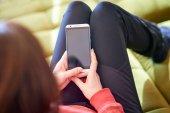 Woman holding blank smart phone screen