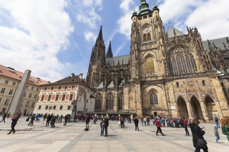 St. Vitus Cathedral and Castle courtyard with tourists in sunny day,  Prague, Czech Republic