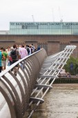 Millennium Bridge over the Thames river, suspension bridge for pedestrians, London, United Kingdom