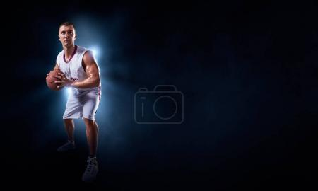 Basketball players on a black background