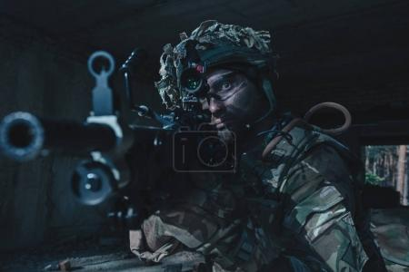Special Forces soldiers in action. A soldier is preparing to make a shot