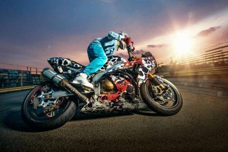 Moto rider making a stunt on his motorbike