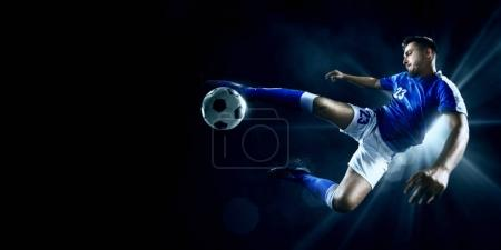Photo for Soccer player performs an action play on a professional stadium. All players wear unbranded clothes. The stadium is made in 3D. - Royalty Free Image