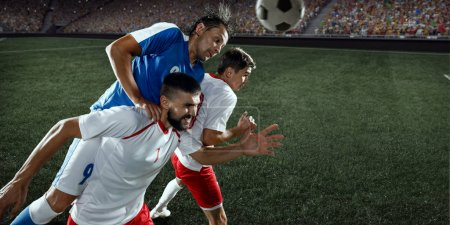 Soccer players performs an action play on a professional stadium