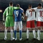 Постер, плакат: Soccer players on a professional stadium