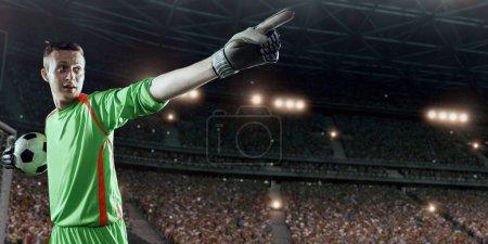 Soccer goalkeeper throws the ball