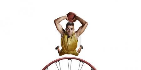 Basketball player make slum dunk on a white background