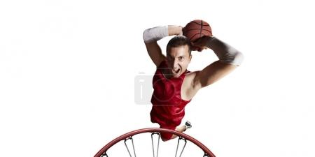 Basketball player make slum dunk on a white background