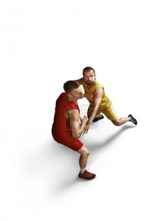 Basketball players make slum dunk on a white background