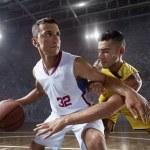Постер, плакат: Basketball players on big professional arena