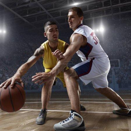 Basketball players on big professional arena