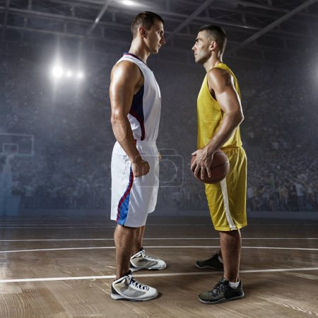 Basketball players on big professional arena before the game