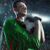 Soccer goalkeeper hold a ball
