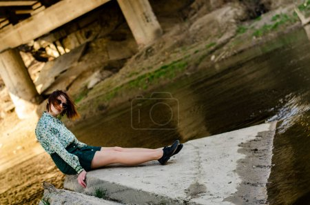 Photo for Beautiful attractive woman posing near river at sunny day - Royalty Free Image