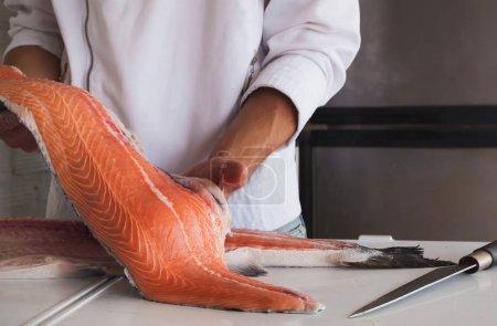 Chef holding fresh piece of salmon