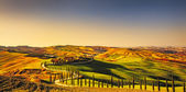 Tuscany, Crete Senesi rural sunset landscape. Countryside farm,