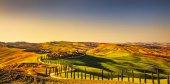 Tuscany, Crete Senesi rural sunset landscape. Countryside farm,