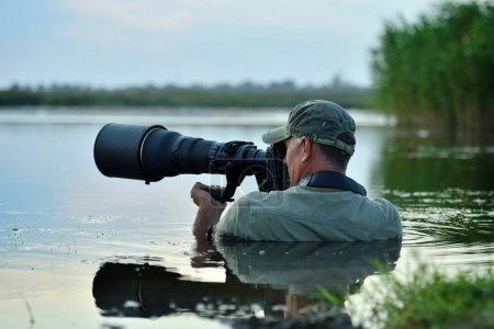 wildlife photographer standing in the water