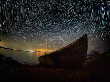 sky at night with startrails over the lake