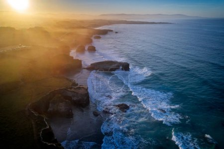 aerial view of famous beach in Northern Spain in the sunset light, Cathedrals beach at the Atlantic Ocean, Cantabric coast Lugo, Galicia, Spain - Playa de las Catedrales
