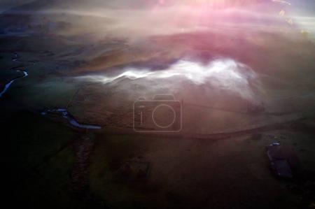 aerial mountain landscape with autumn morning fog at sunrise, Fundatura Ponorului, Hunedoara county - Romania