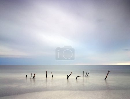 Stunning long exposure blur sunrise landsdcape of idyllic