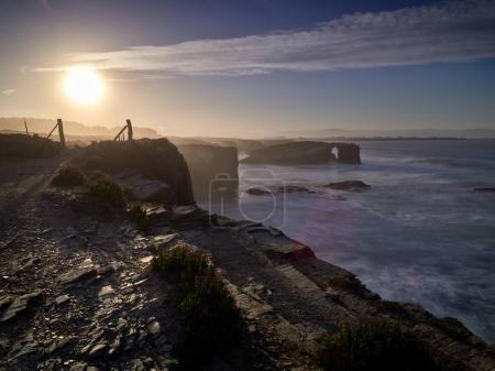 Beautiful sunset and stone arches on Playa de las Catedrales dur