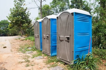 Photo for Blue Port Potties or Portable Toilets in nature public park - Royalty Free Image