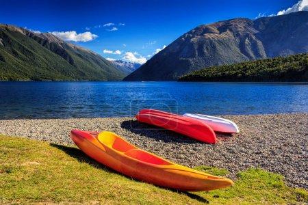 kayaks and mountain lake, location - Nelson Lakes National Park, New Zealand