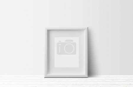 empty white photo frame on light wooden floor and white wall background