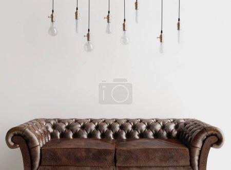 Photo pour Canapé en cuir marron avec ampoules suspendues au plafond - image libre de droit