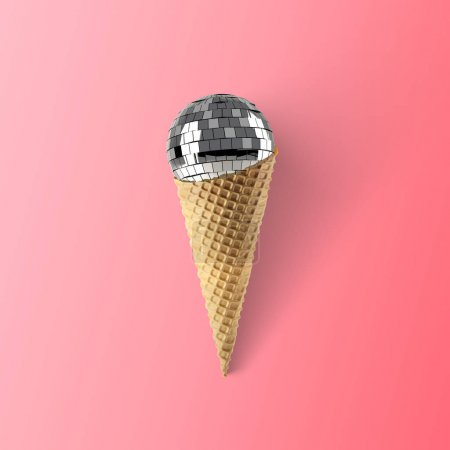 waffle cone with disco ball on pink background, party food concept