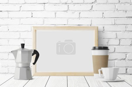 empty photo frame with old metal coffee maker and coffee cups