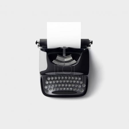 Photo for Retro typewriter with empty white paper - Royalty Free Image