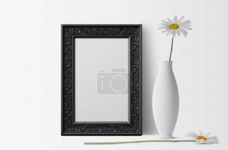 Photo for Empty photo frame with white chamomiles and vase - Royalty Free Image