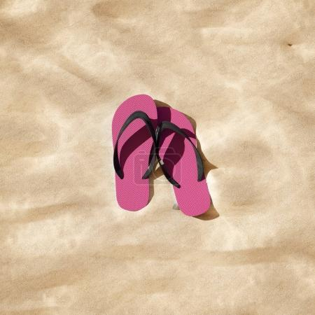 flip flops on sandy beach, close up with copy space