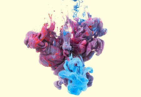 splash of red and blue paint. Ink in water