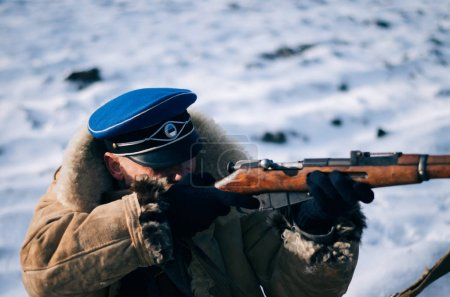 ESTONIA - FEBRUARY 24, 2017: Soldier shooting, historic reconstruction play on independence day of estonia