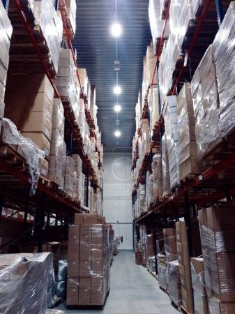 Storage racks with cardboard boxes