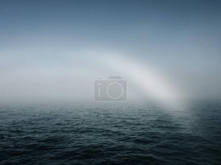 Mist rainbow at sea