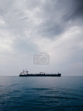Photo for Seascape with a cargo vessel in a cloudy day - Royalty Free Image