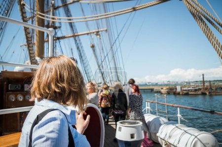 young woman on yacht deck