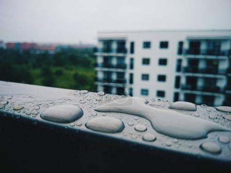 wet balcony sill with rain drops