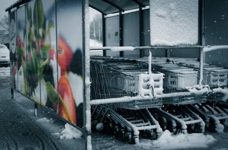 Supermarket carts under awning